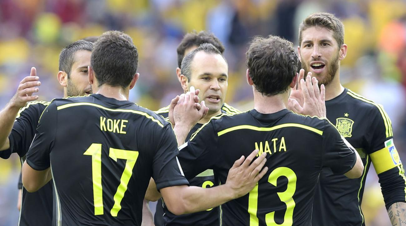 Spain celebrates after scoring a goal during the group B World Cup soccer match against Australia.