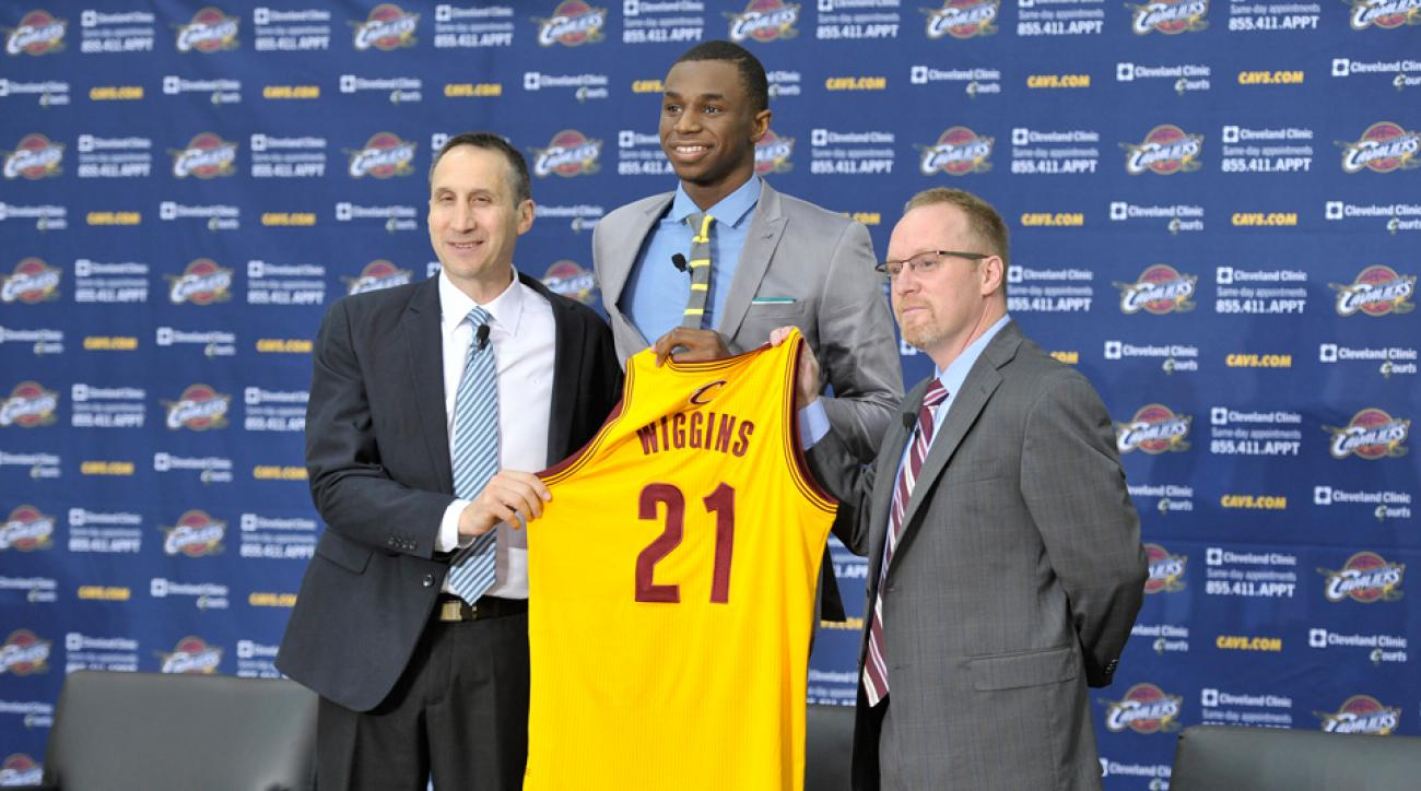 Andrew Wiggins (center) was introduced by Cavaliers coach David Blatt (left) and GM David Griffin (right).