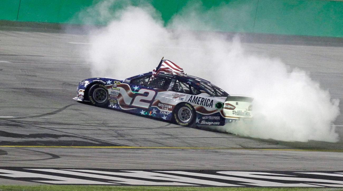 Brad Keselowski does a burnout after winning the NASCAR Sprint Cup series auto race at Kentucky Speedway in Sparta, Ky.