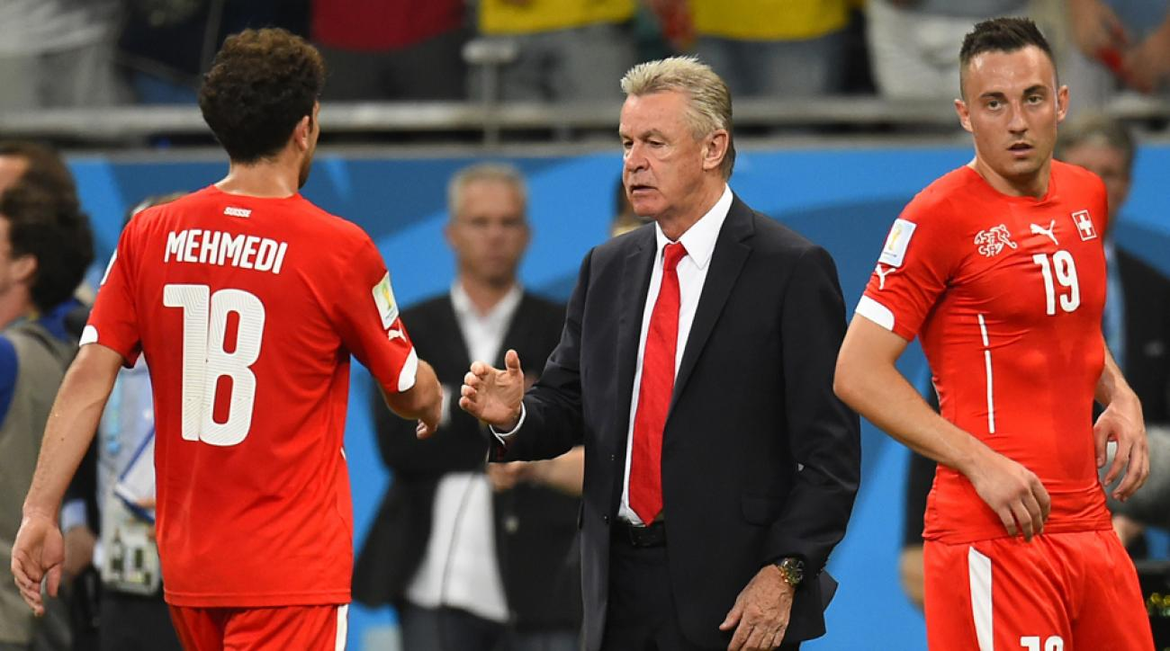 The brother of Switzerland manager Ottmar Hitzfeld, center, passed away on the eve of the Swiss' round of 16 game against Argentina.