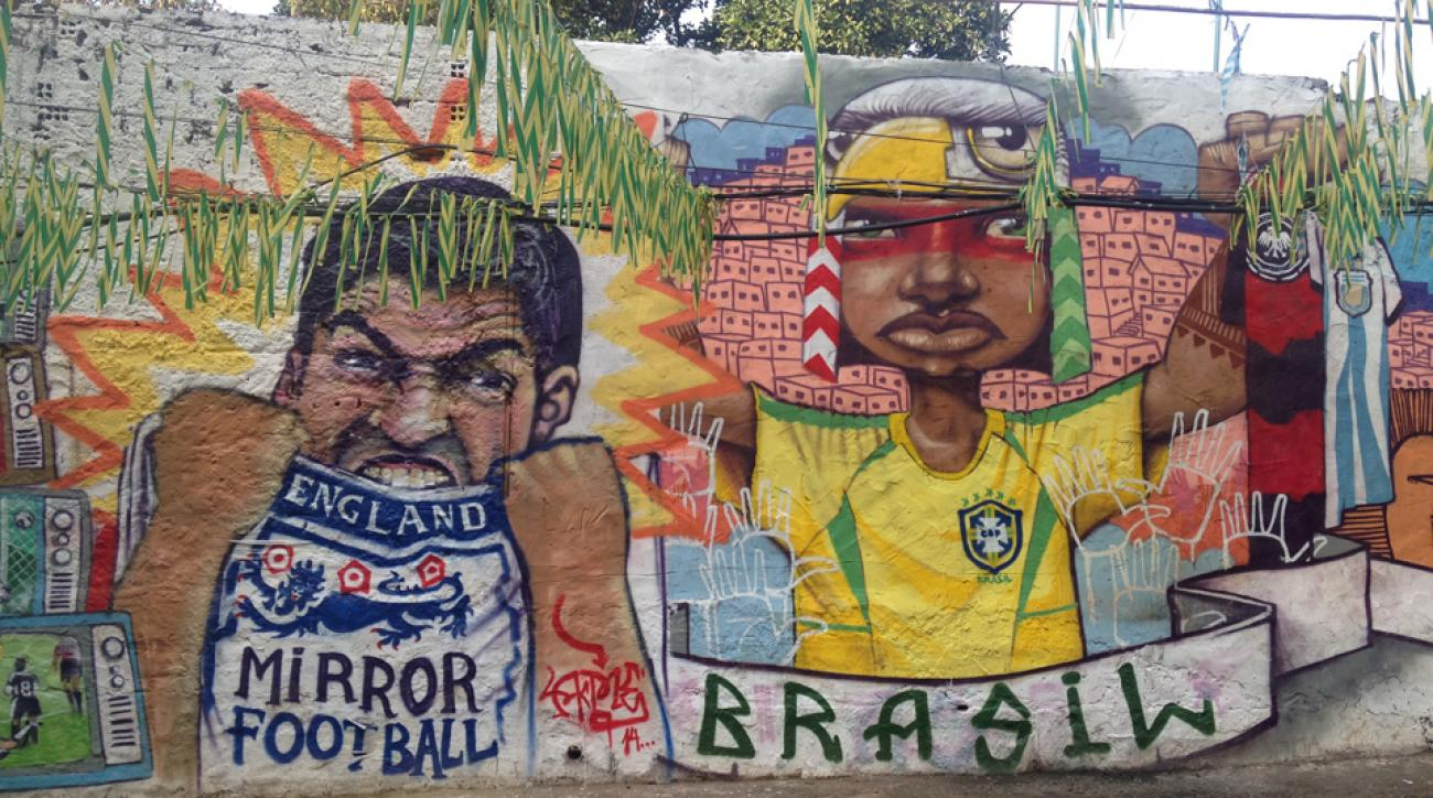 Soccer themed graffiti is widely encouraged and accepted in rio de janeiro with intricate
