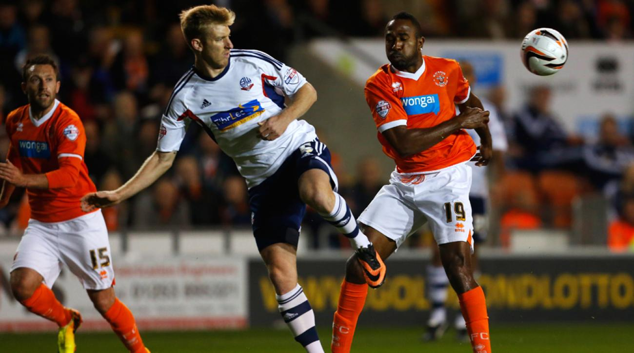 U.S. defender Tim Ream, center, has signed a three-year extension to remain at Bolton.
