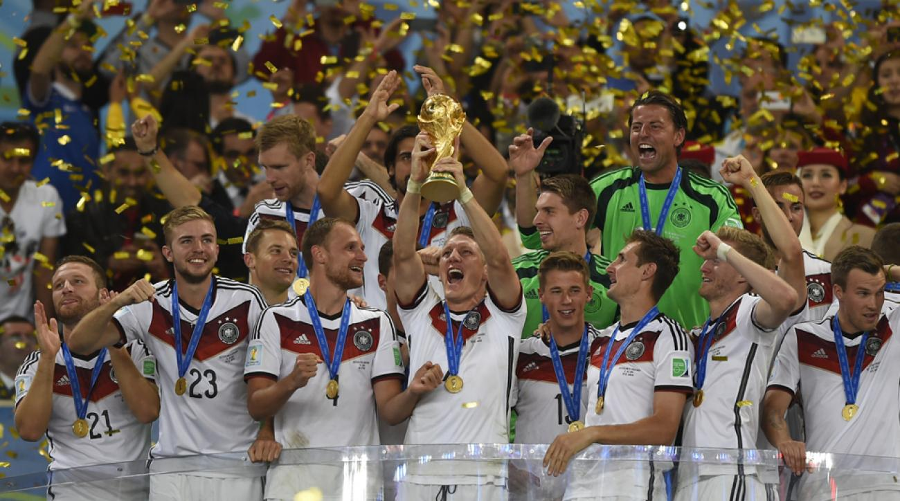 Germany veteran Bastian Schweinsteiger hoists the World Cup trophy after a 1-0 extra-time triumph over Argentina in Sunday's final.