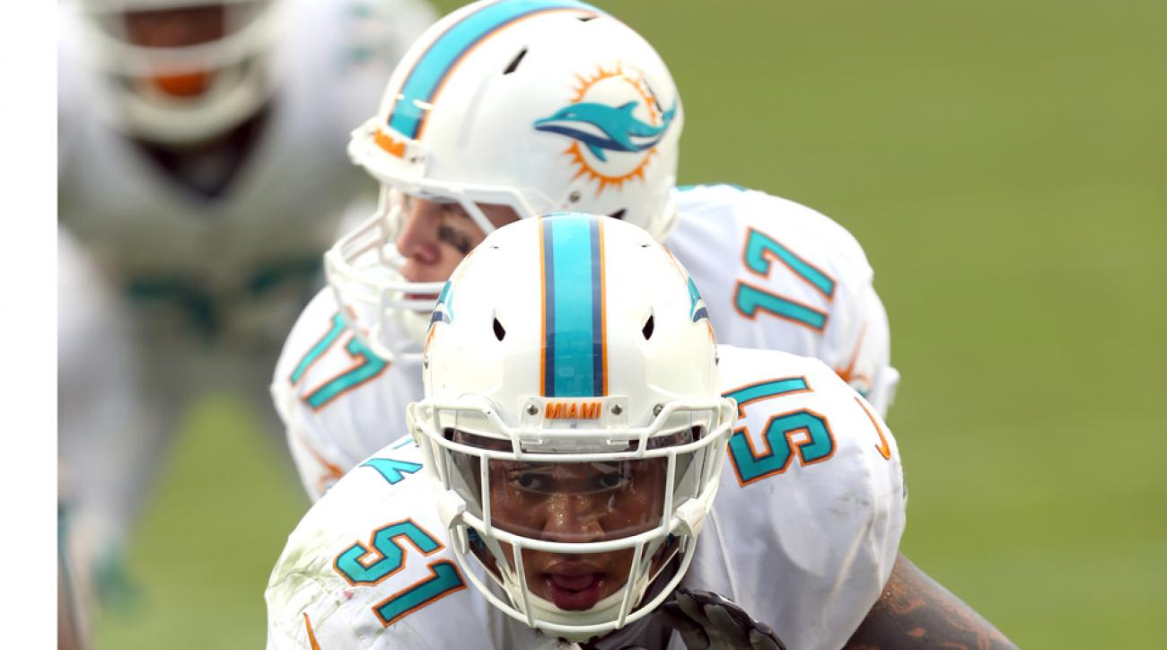 Dolphins' Mike Pouncey will not face ban for role in bullying scandal