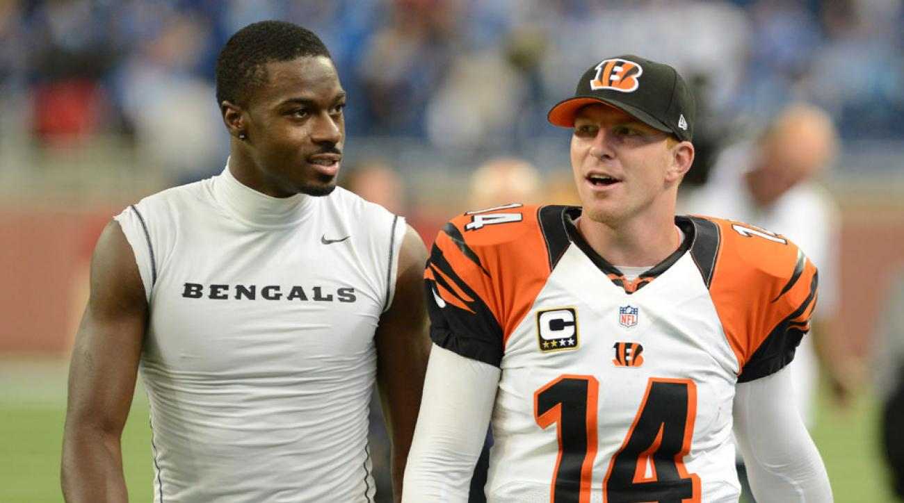 A.J. Green (left) believes the Bengals will re-sign Andy Dalton (right) before the season starts