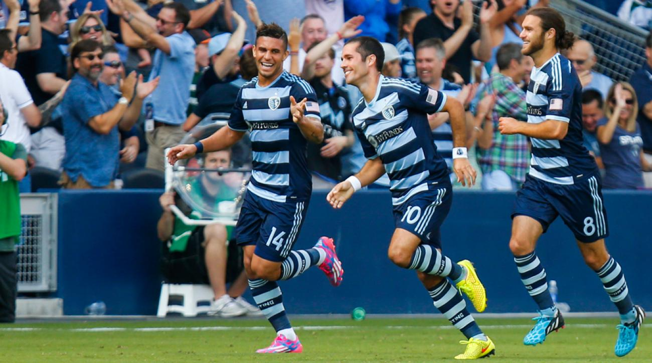 Benny Feilhaber, center, celebrates his goal for Sporting Kansas City against the LA Galaxy with teammates Dom Dwyer, left, and Graham Zusi.