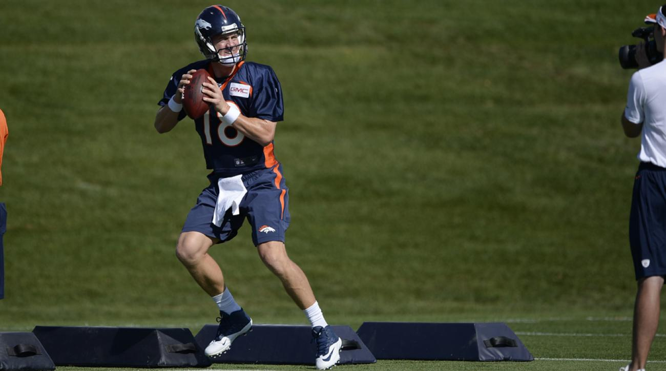 Broncos quarterback Peyton Manning practices at training camp.