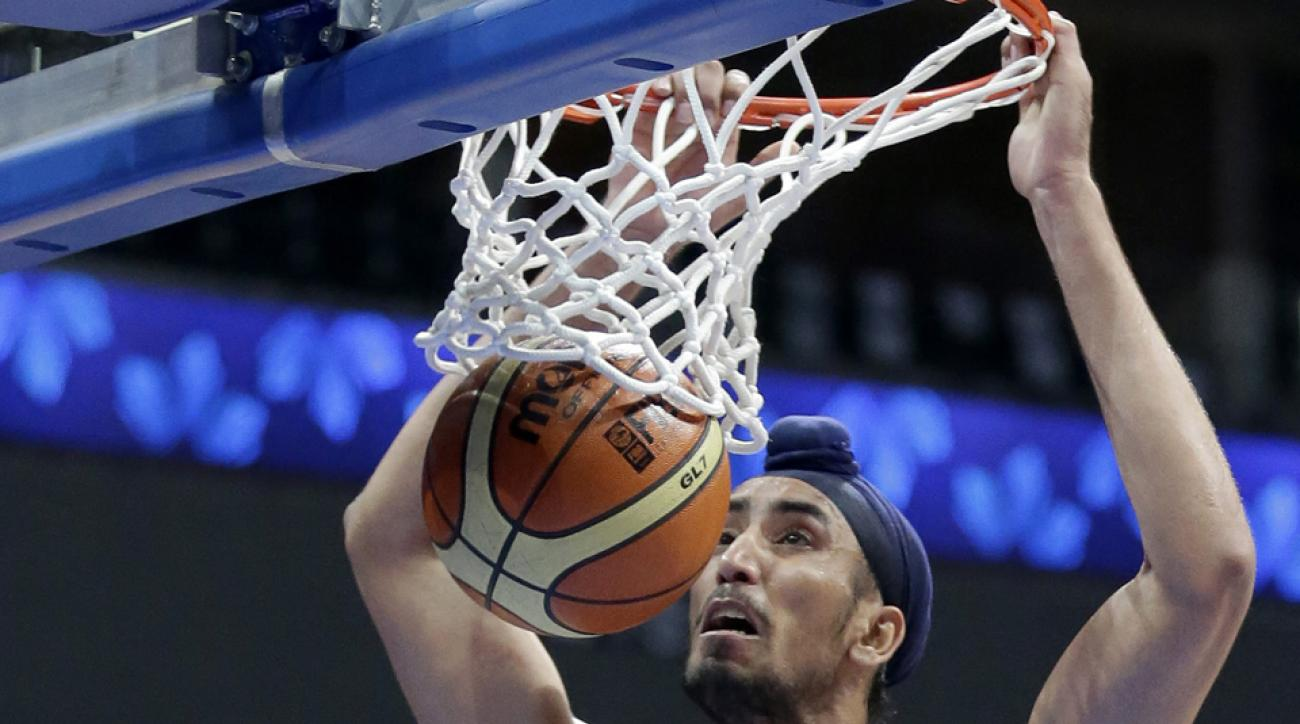 India's Amjyot Singh is shown wearing headgear during the FIBA Asia Basketball Championship last August.