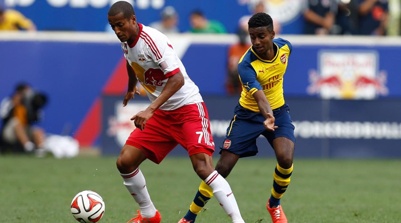 Gedion Zelalem, right, goes up against Roy Miller in Arsenal's friendly against the New York Red Bulls on Saturday.