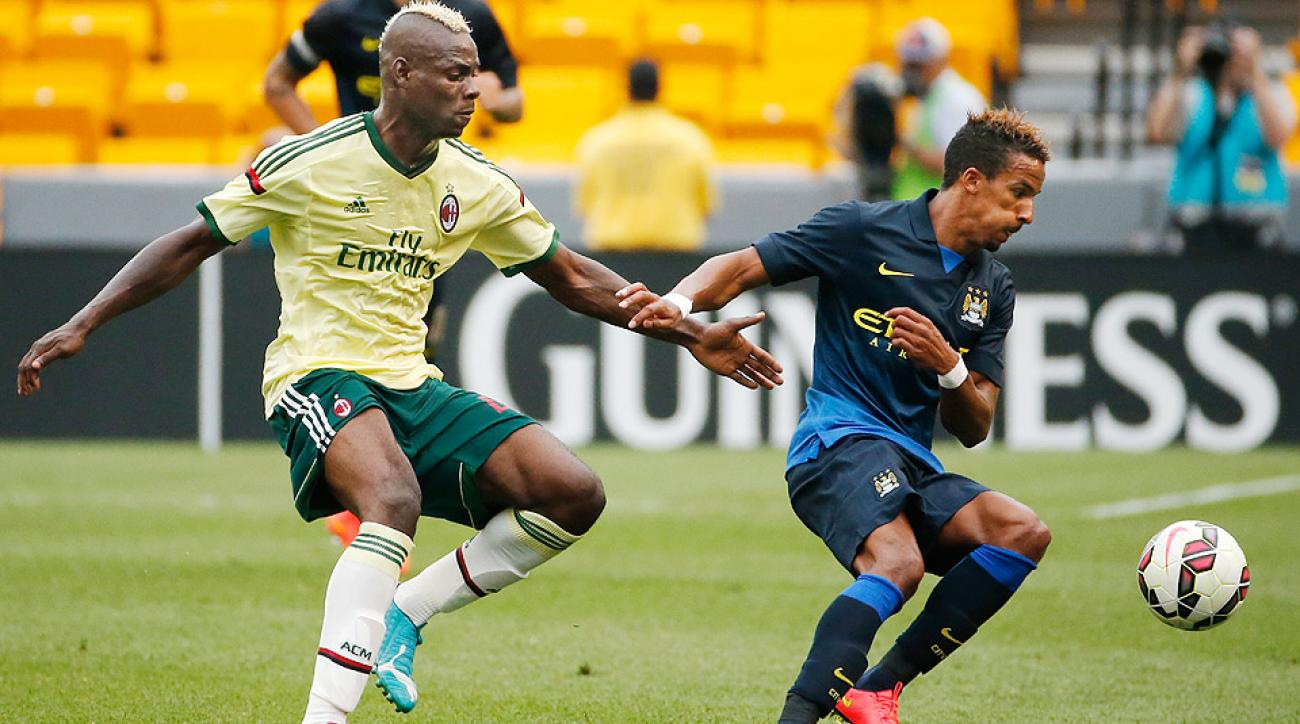 Milan's Mario Balotelli (left) battles Manchester City's Scott Sinclair at the Guinness International Champions Cup