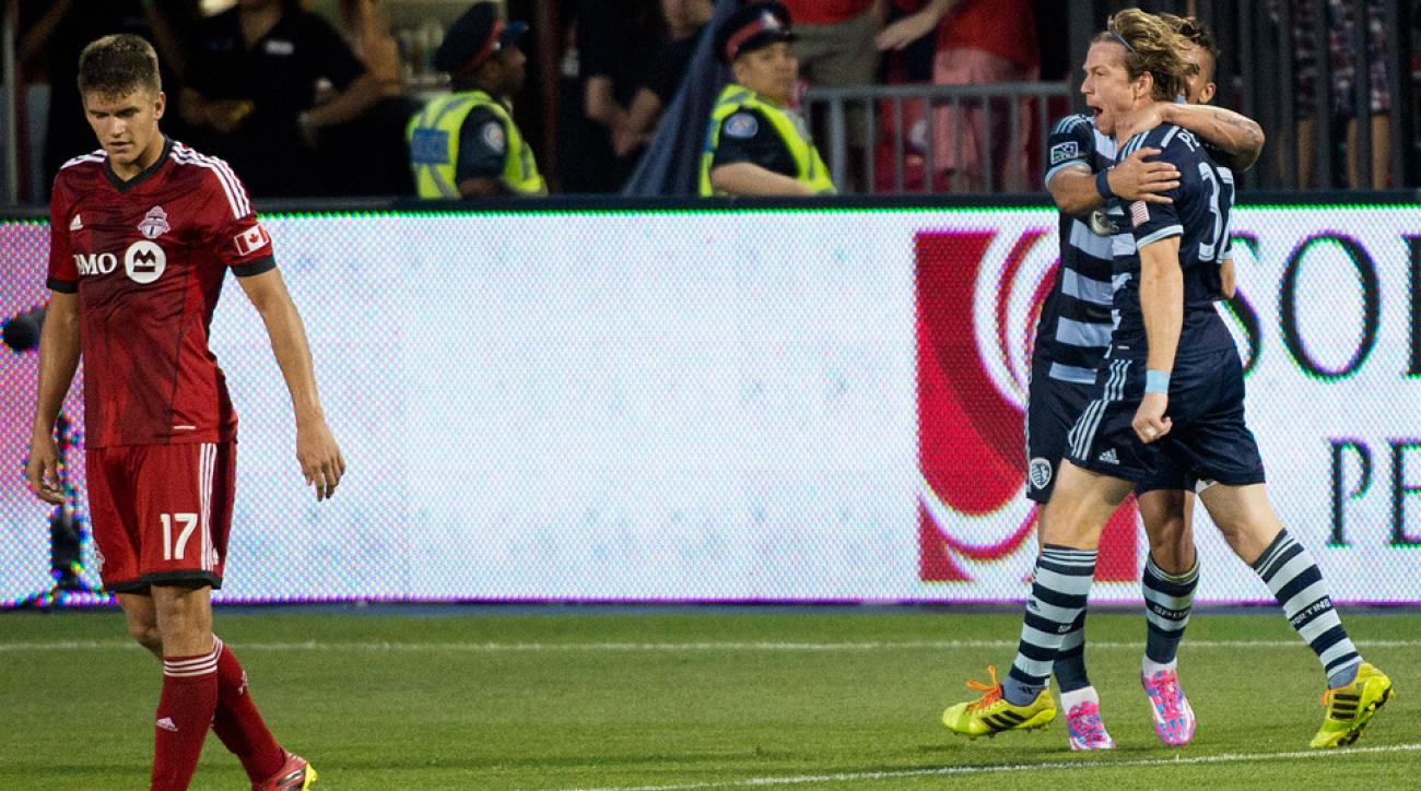 Sporting Kansas City's Jacob Peterson, right, celebrates his game-winning goal against Toronto FC on Saturday.