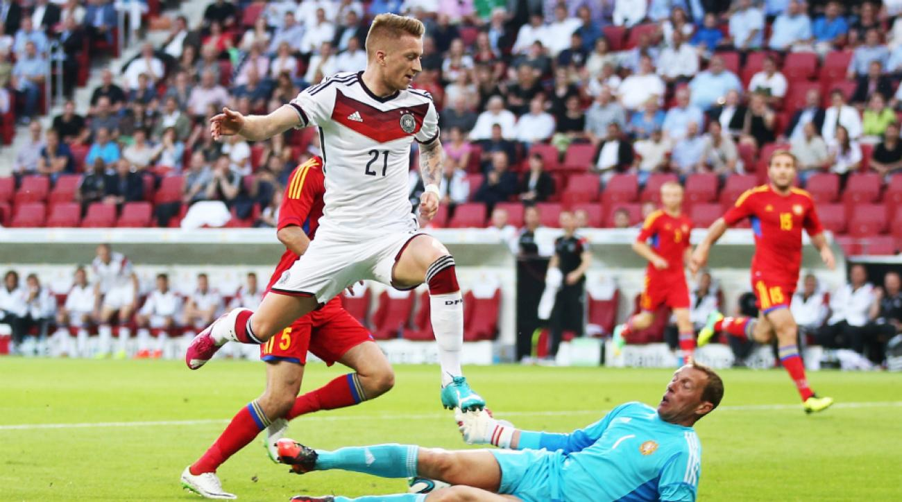 Borussia Dortmund CEO says midfielder Marco Reus wants to stay