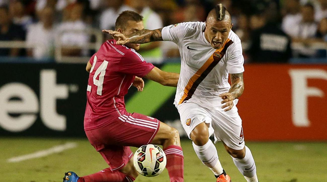 Real Madrid midfielder Asier Illarramendi (24) competes for control of the ball against Roma's Radja Nainggolan.