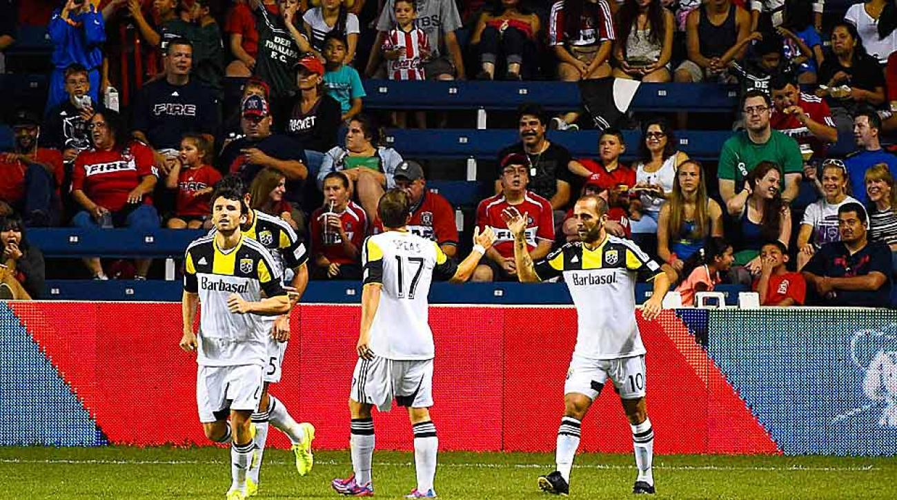 Columbus' Federico Higuain (10) celebrates his second-half equalizer vs. the Chicago Fire that earned the Crew a crucial point on the road.