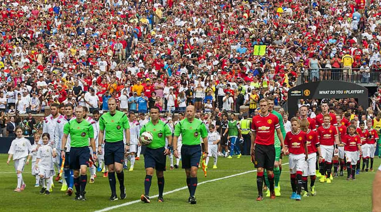 Saturday's match at Michigan Stadium between Real Madrid (white) and Manchester United broke the US' record for soccer attendance with 109, 318 fans on hand.