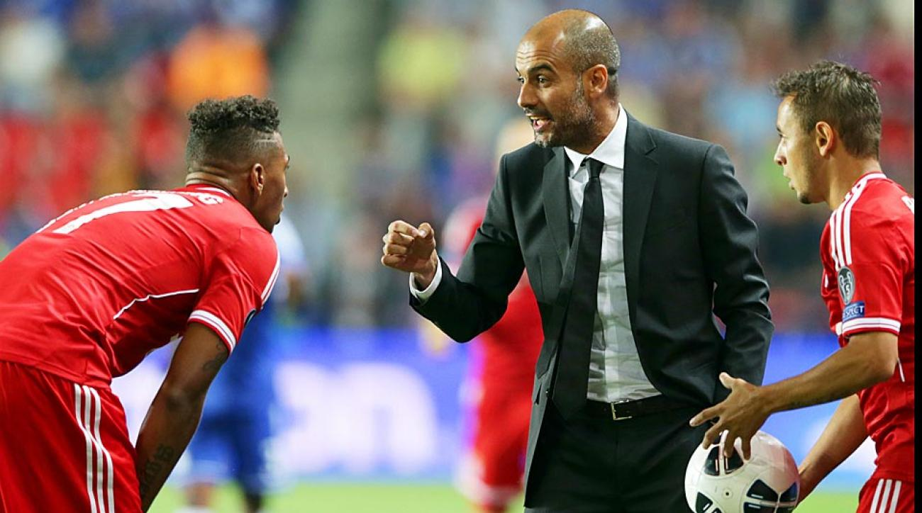 Bayern Munich manager Pep Guardiola said prized defender Jerome Boateng (left) is '100 percent' a part of his plans for the 2014-15 season, despite transfer rumors.