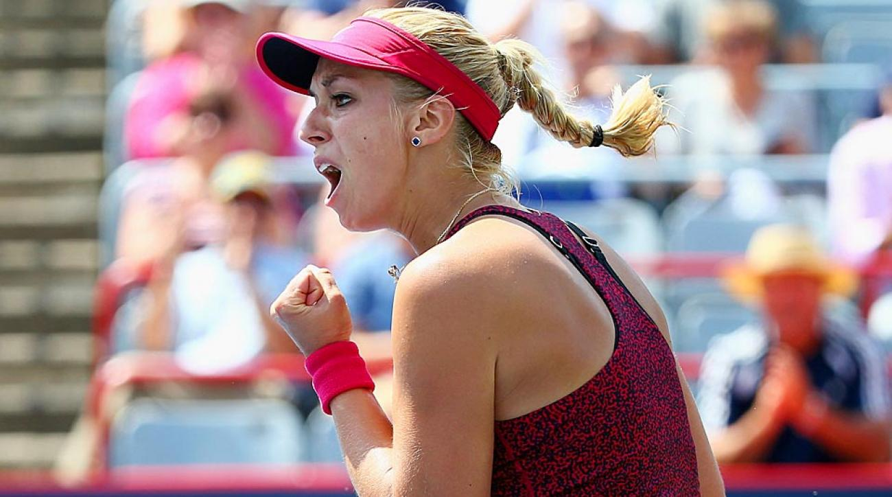 Sabine Lisicki reacts to her upset of 13th-seeded Sara Errani in the opening round of the Rogers Cup.