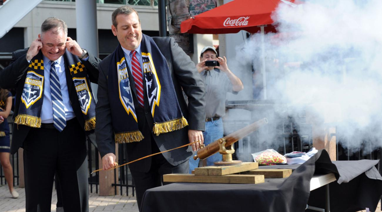 NASL commissioner Bill Peterson fires a mini cannon while welcoming the expansion franchise in Jacksonville during a February ceremony.