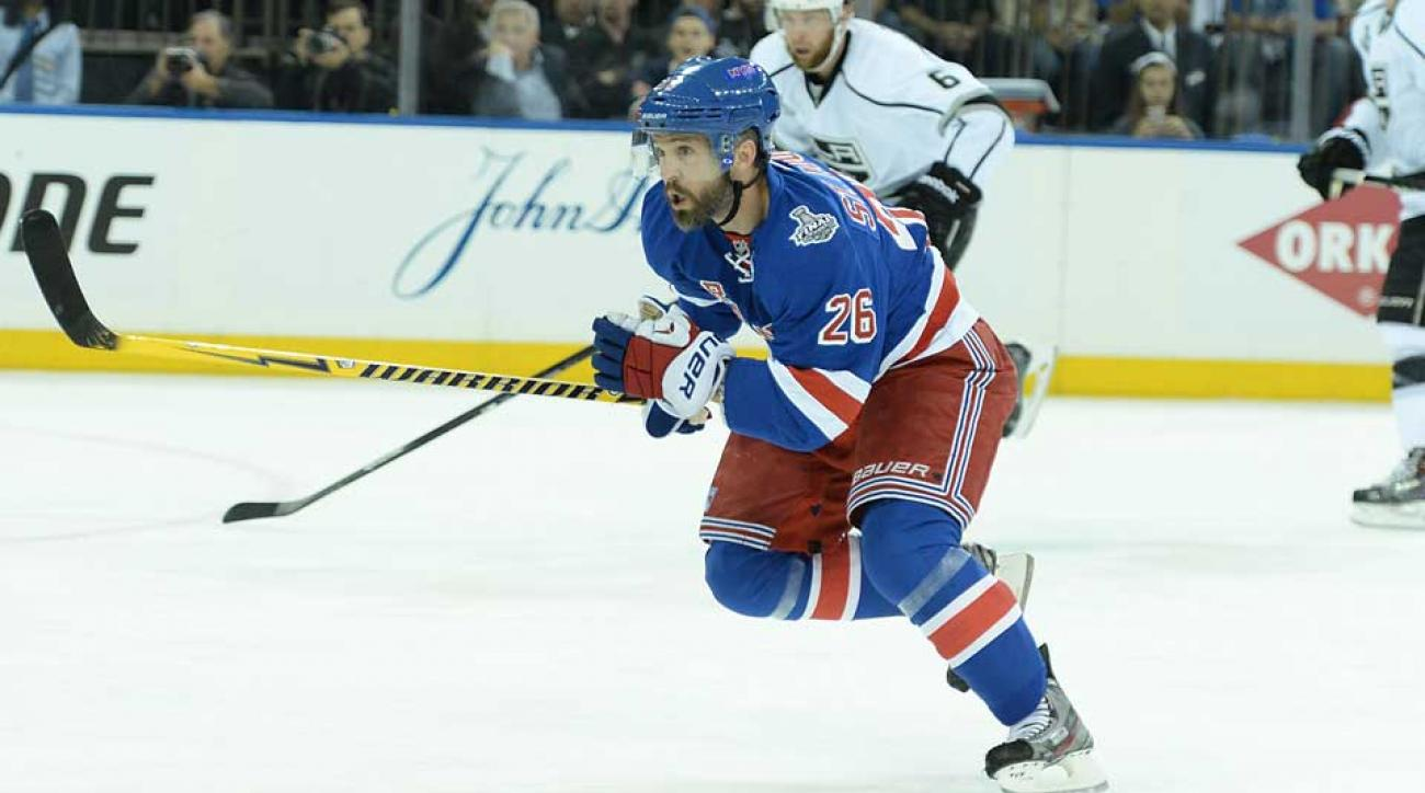 Martin St. Louis, who scored eight goals during the Rangers' run to the Stanley Cup finals last spring, will be back in New York in 2014–15.