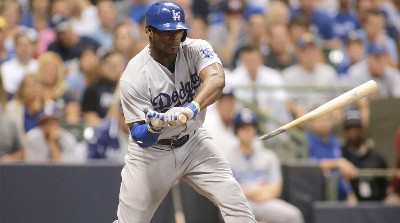 Los Angeles Dodgers outfielder Yasiel Puig broke his bat on a check swing against the Milwaukee Brewers.