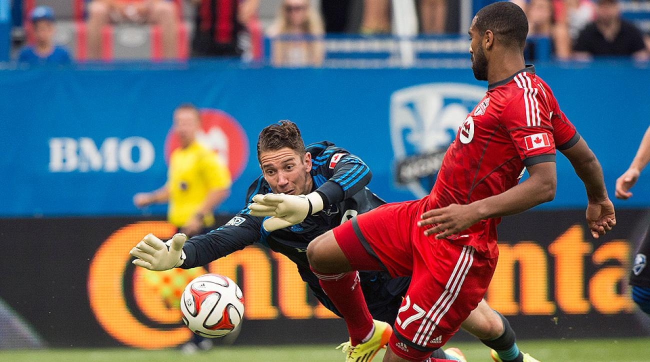 Toronto FC's Luke Moore, shown scoring on Montreal Impact goalkeeper Troy Perkins on Aug. 2, netted the decisive goal against the Columbus Crew.