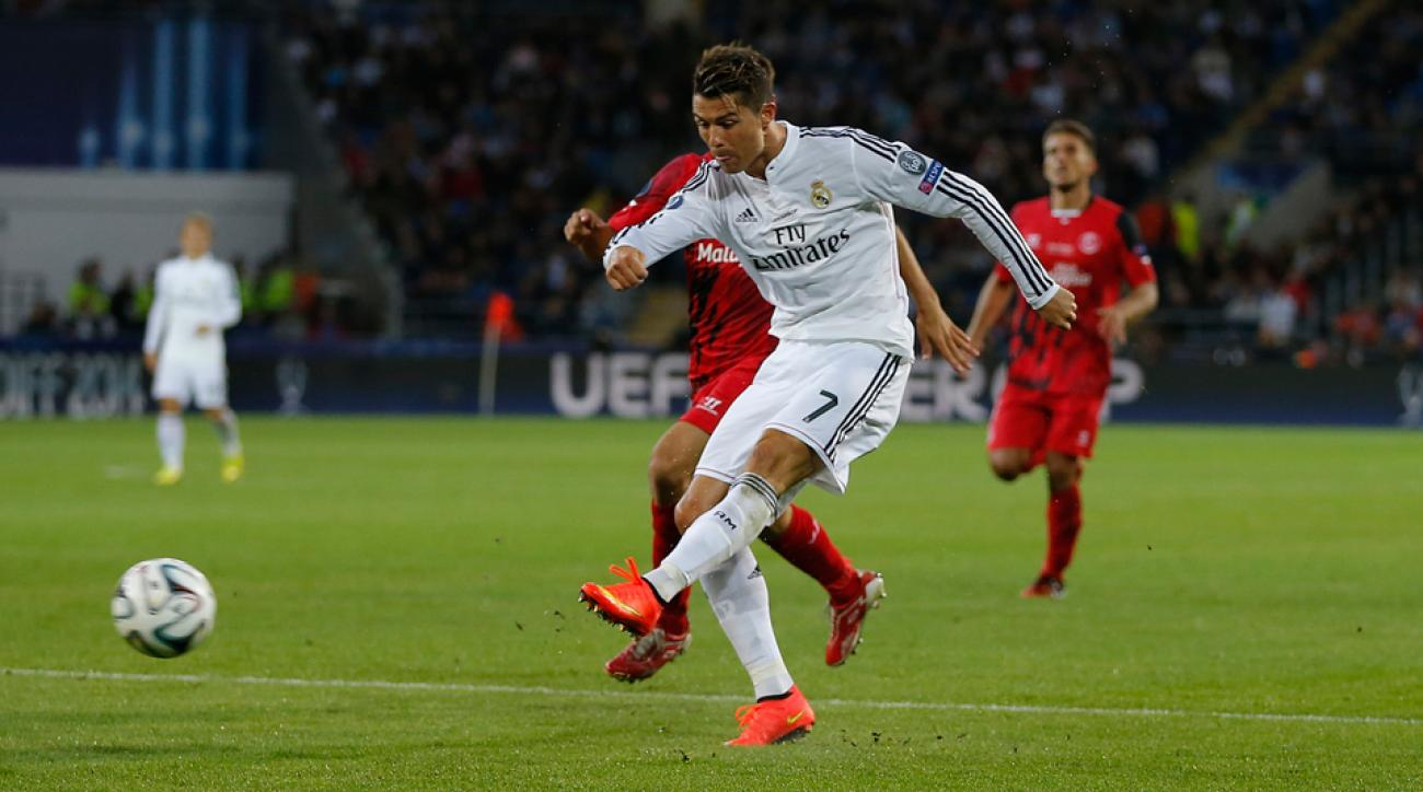 Cristiano Ronaldo lets a left-footed blast fly for his second goal, leading Real Madrid to a 2-0 win over Sevilla in the UEFA Super Cup.