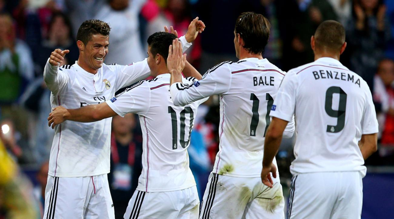 A line of Real Madrid stars wait to congratulate Cristiano Ronaldo, as (from left) James Rodriguez, Gareth Bale and Karim Benzema greet the Portuguese star after his goal in the UEFA Super Cup.