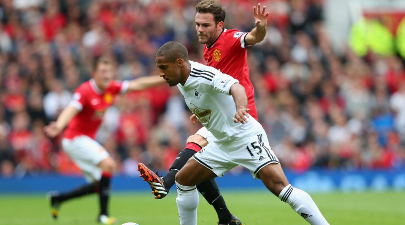 Swansea City got their season off to the best possible start with an away win over Manchester United at Old Trafford.