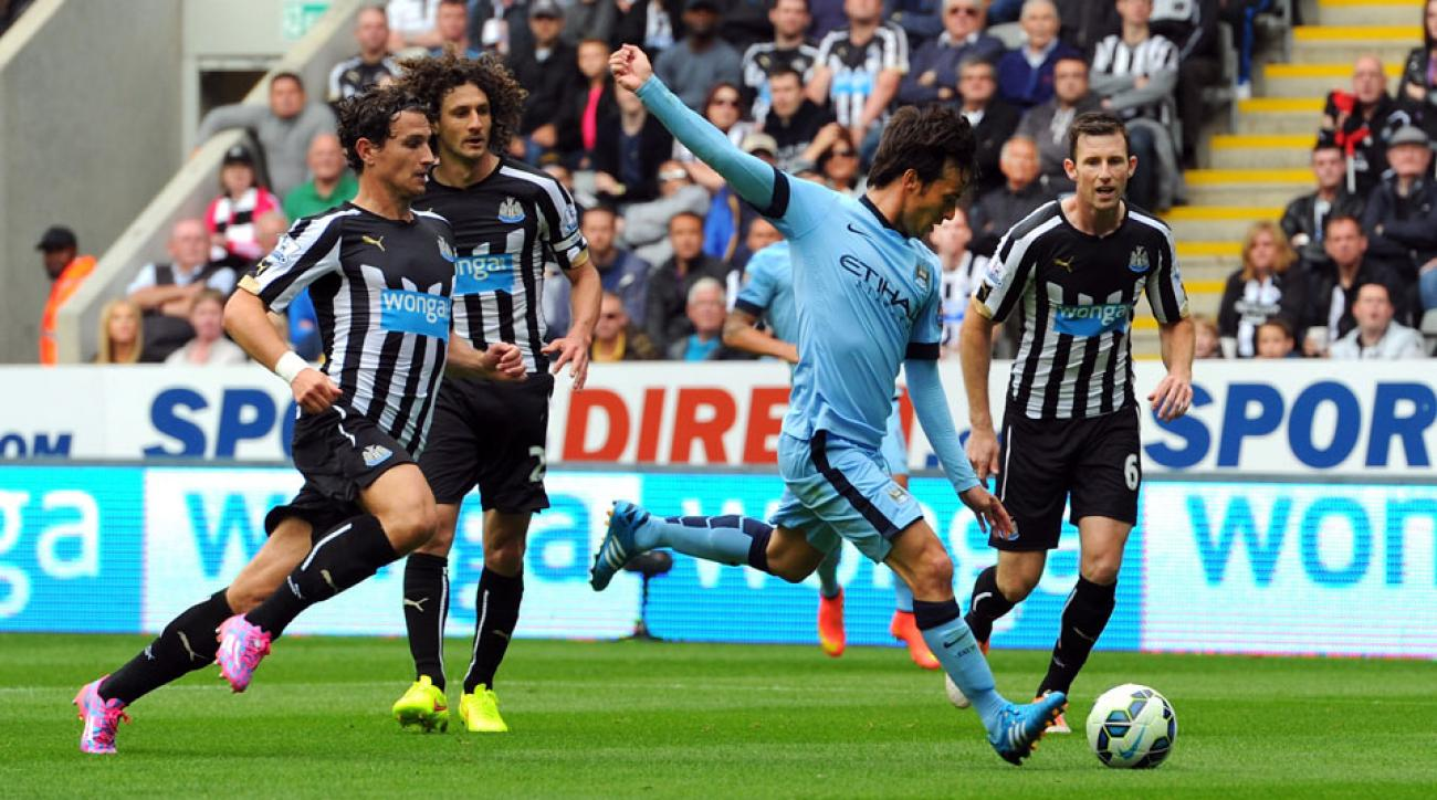 David Silva opened the scoring for Manchester City in the defending champions' 2-0 win over Newcastle United at St. James' Park.
