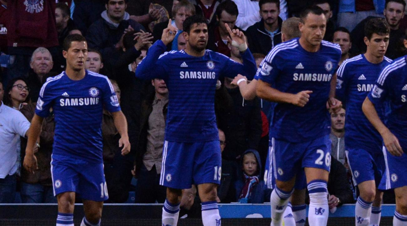 Diego Costa, second from left, celebrates scoring on his Chelsea debut as part of a 3-1 win over Burnley.