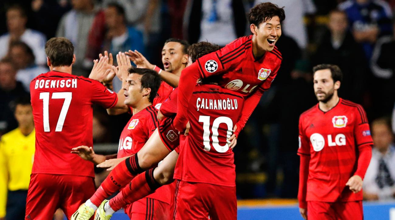 Bayer Leverkusen's Heung-Min Son gets hoisted in celebration after scoring vs. FC Copenhagen in their Champions League playoff opening leg.