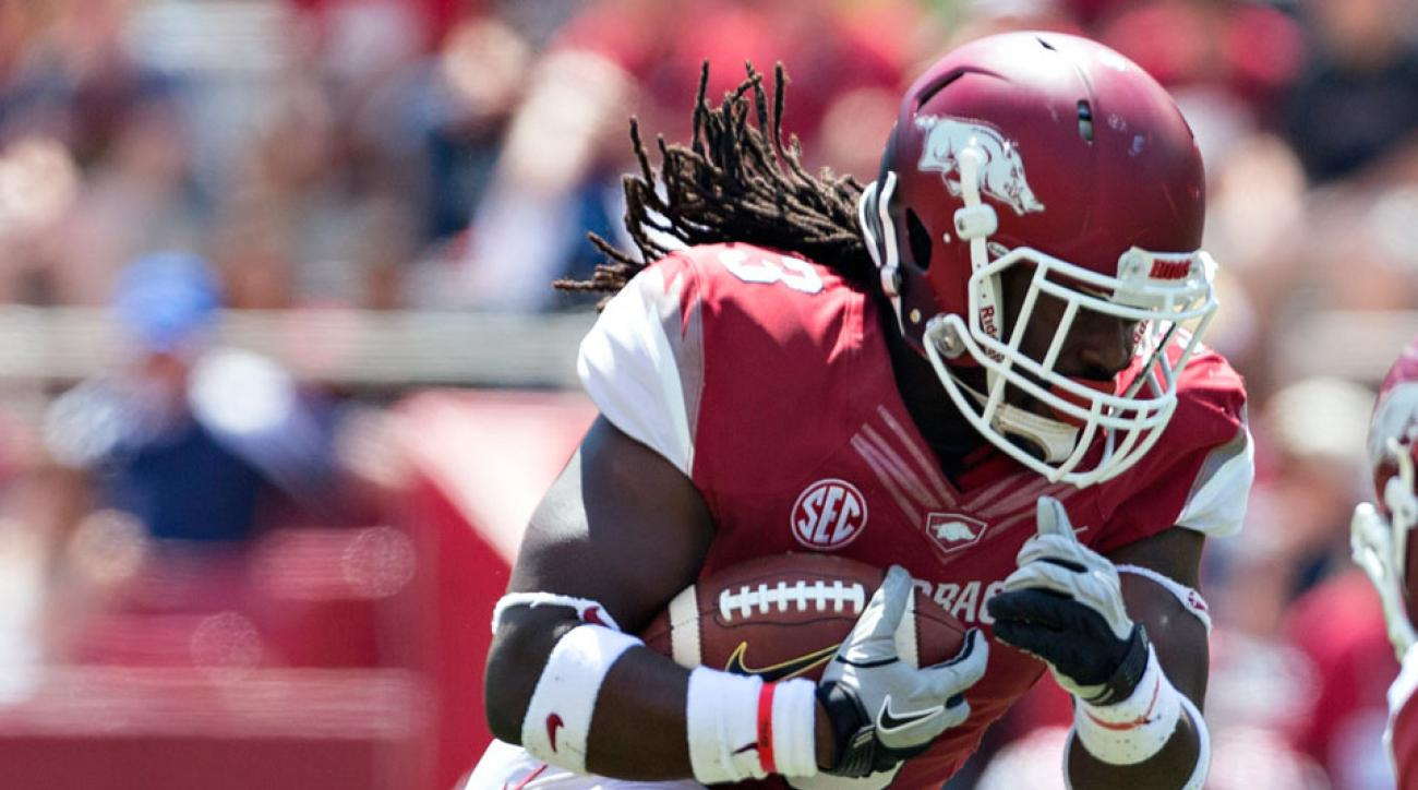 Alex Collins of the Arkansas Razorbacks runs the ball during the Red White Spring Football game