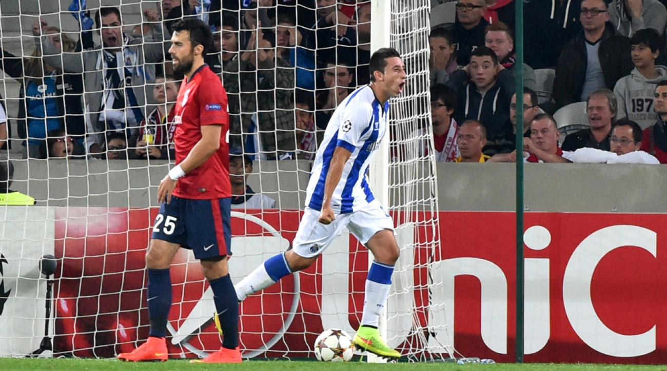 Mexico international Hector Herrera, right, celebrates his goal for Porto that lifted the Portuguese club to a 1-0 win over Lille in the Champions League playoff round.