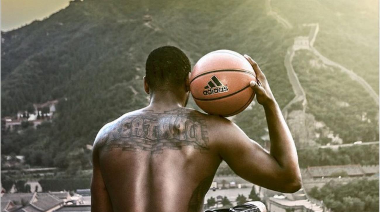 Washington Wizards John Wall shows off his tattoo at the great wall