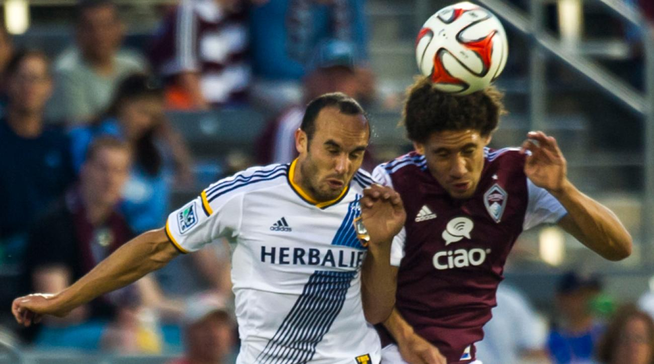Landon Donovan, left, challenges Chris Klute for a header in the LA Galaxy's 4-3 win over the Colorado Rapids Wednesday night.