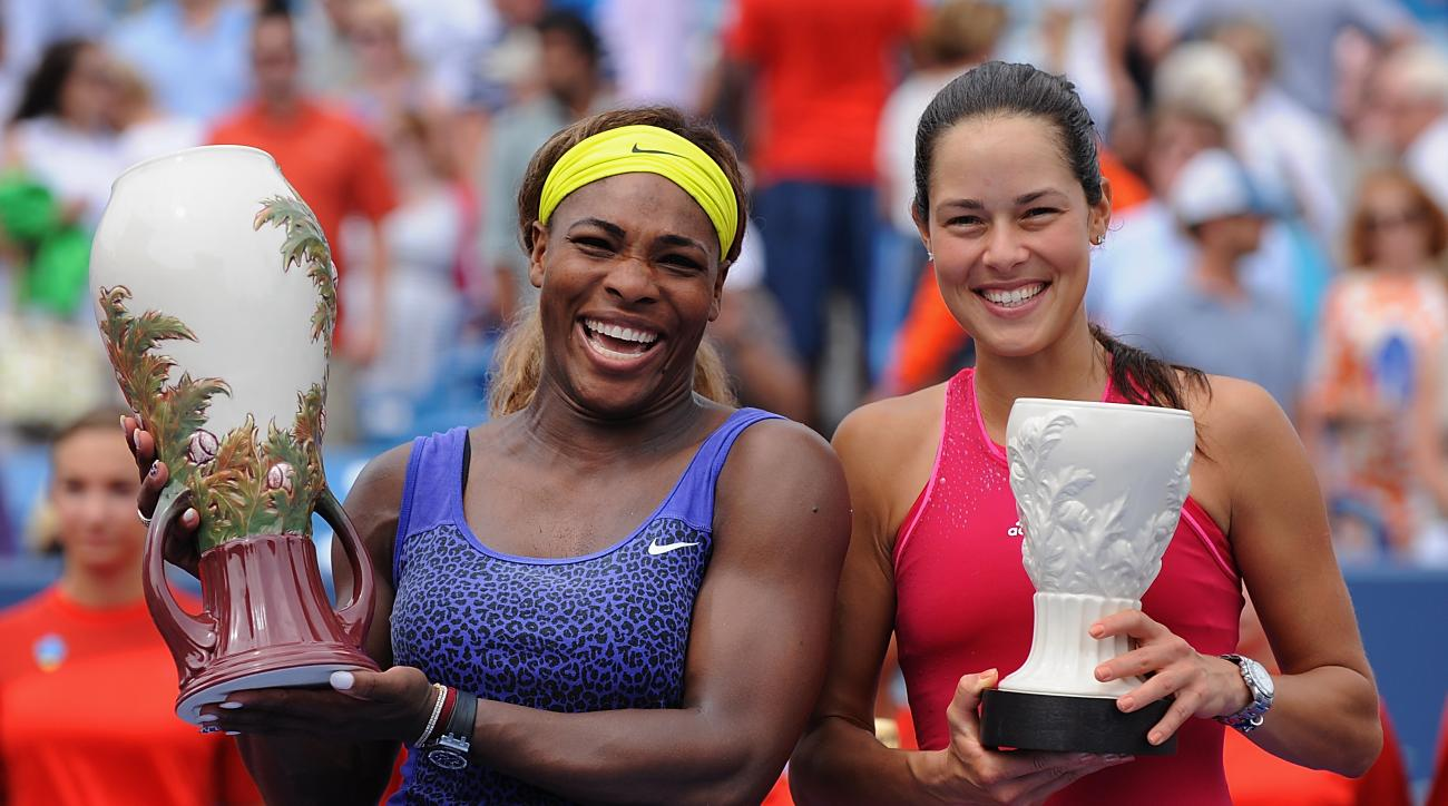 Serena Williams and Ana Ivanovic pose with their trophies after the final match  of the Western & Southern Open in August.