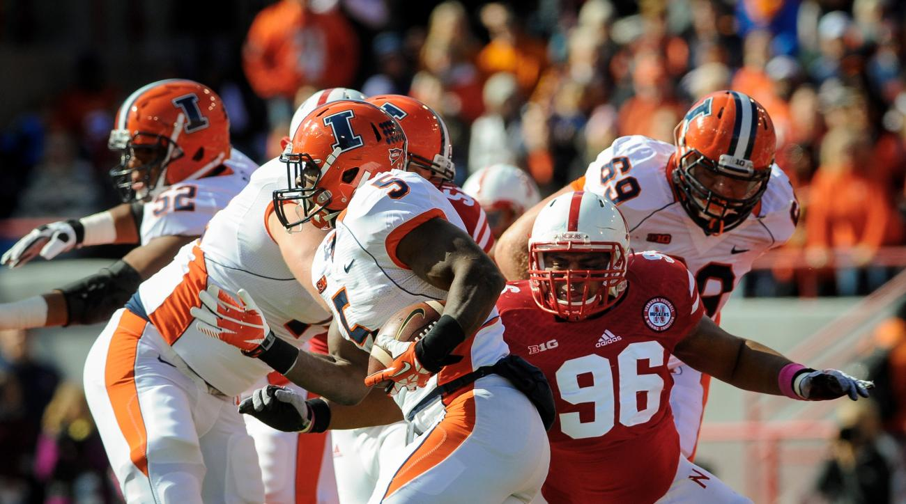 Former Huskers defensive lineman Aaron Curry (pictured No. 96)