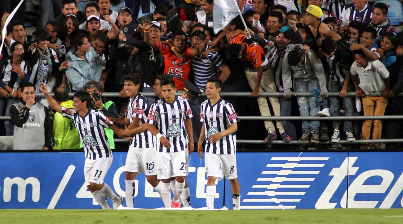 Matias Alustiza, left, celebrates a goal during his hat trick in Pachuca's win over Atlas in Liga MX.