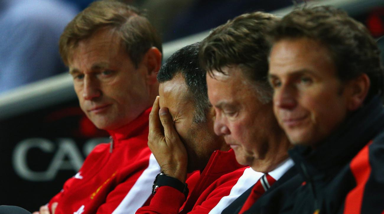 Manchester United assistant manager Ryan Giggs can't bear to watch as the Red Devils lose 4-0 to MK Dons in the League Cup.