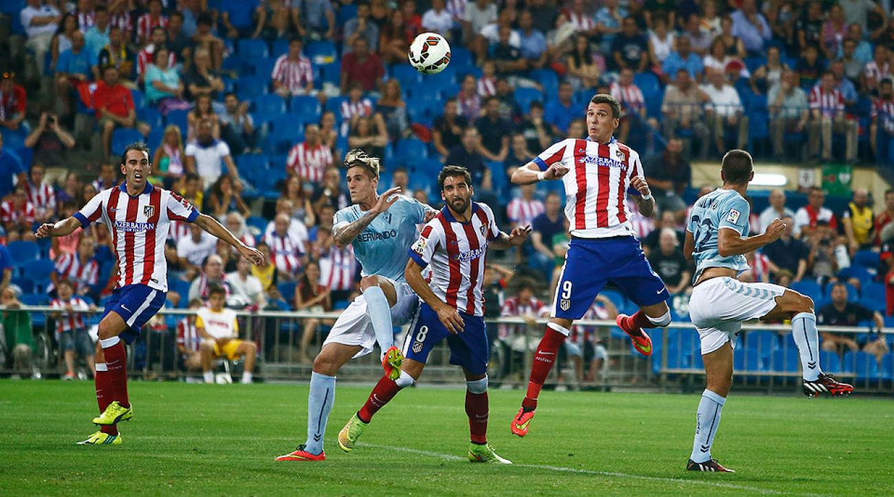 Atletico Madrid held on to beat Eiba 2-1 for an unconvincing first win of the Spanish League season.