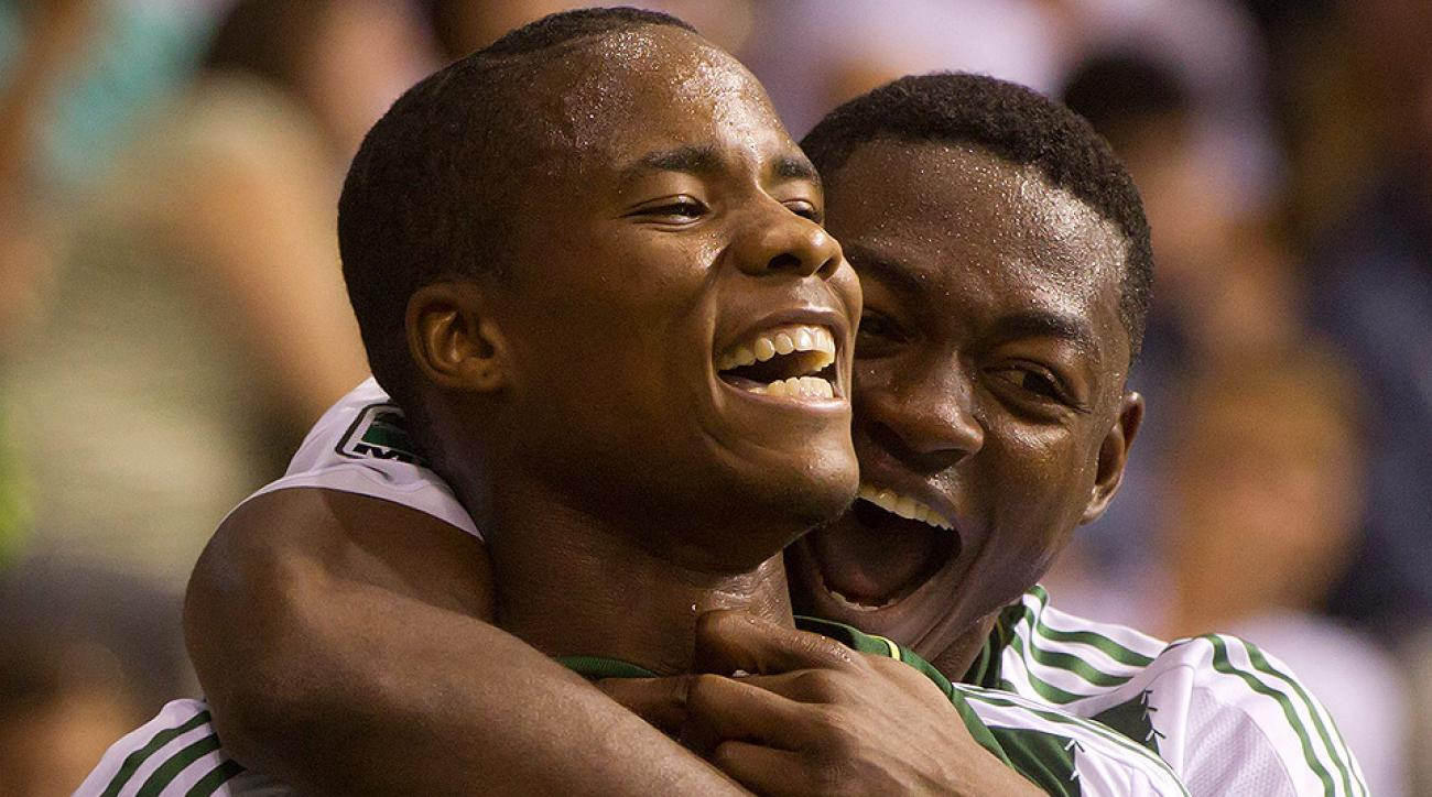 Portland's Alvas Powell (left) and Fanendo Adi celebrate Powell's second-half goal against Vancouver.