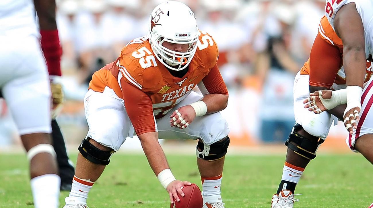 Texas center Dominic Espinosa breaks ankle