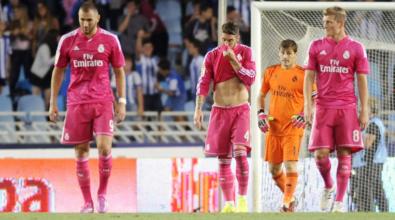 Real Madrid's Karim Benzema (left), Sergio Ramos, Iker Casillas and Toni Kroos react after Real Sociedad scored their fourth goal.