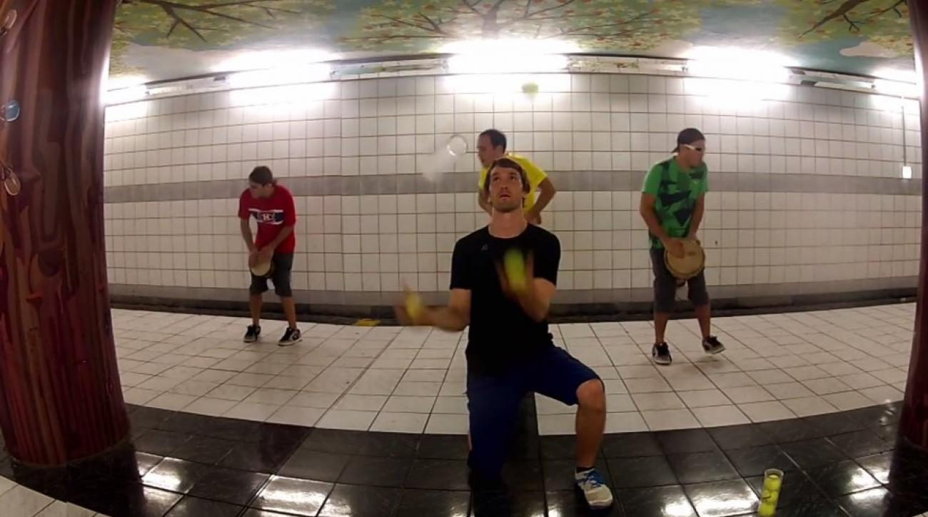 Tennis ball juggling along with a drum line