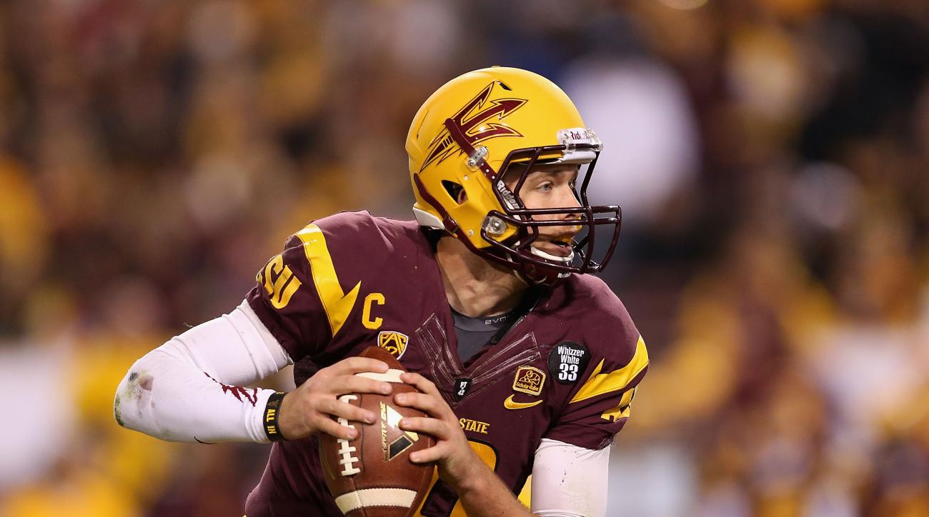 Quarterback Taylor Kelly of the Arizona State Sun Devils drops back to pass during the Pac 12 Championship game against the Stanford Cardinal at Sun Devil Stadium on December 7, 2013 in Tempe, Arizona.