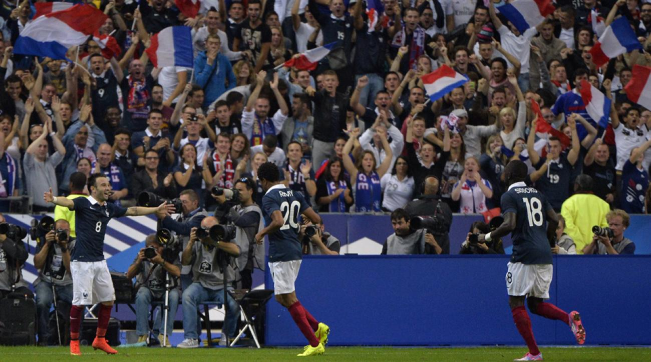 Loic Remy, center, celebrates his goal that lifted France to a 1-0 win over Spain in Thursday's friendly.
