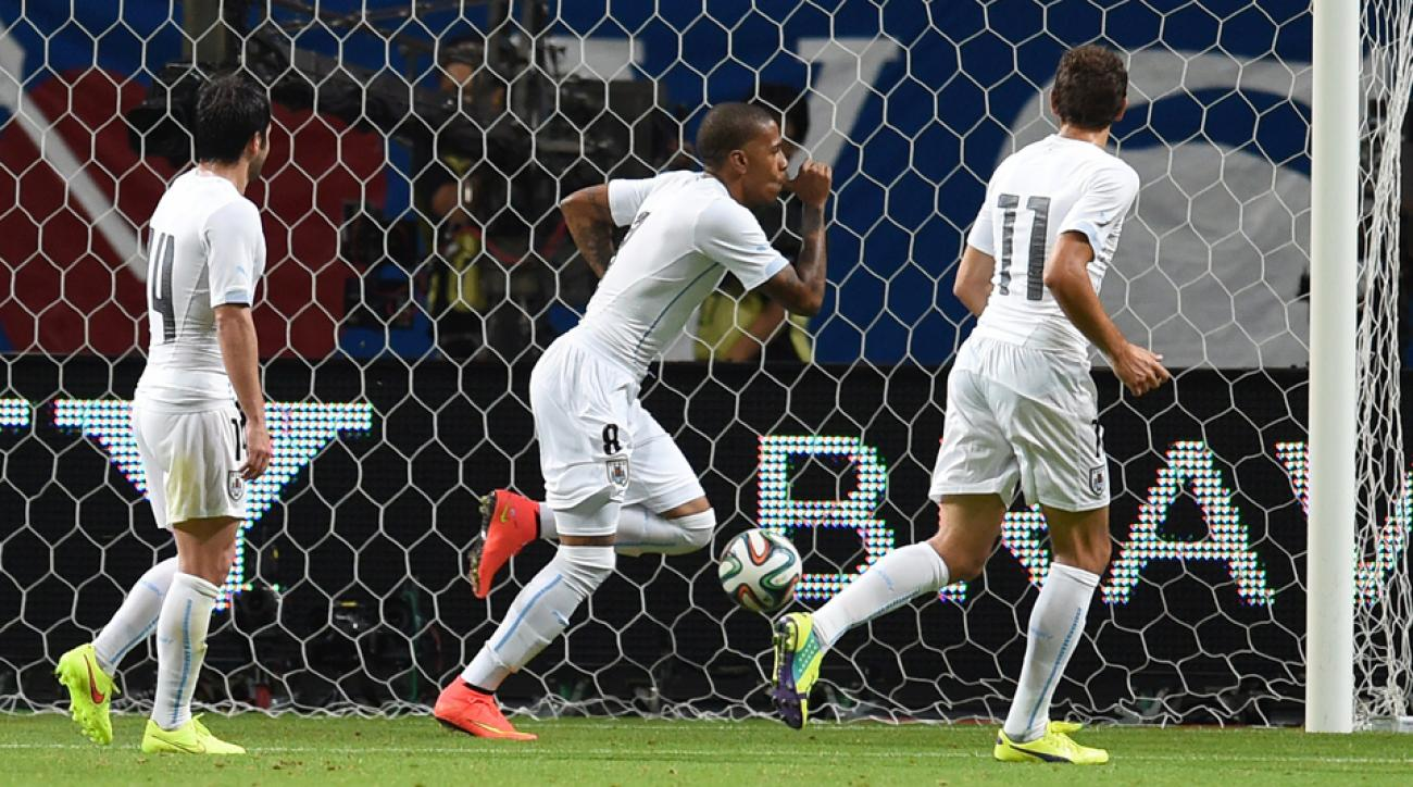 Abel Hernandez, center, celebrates his goal during Uruguay's 2-0 win over Japan in a friendly.