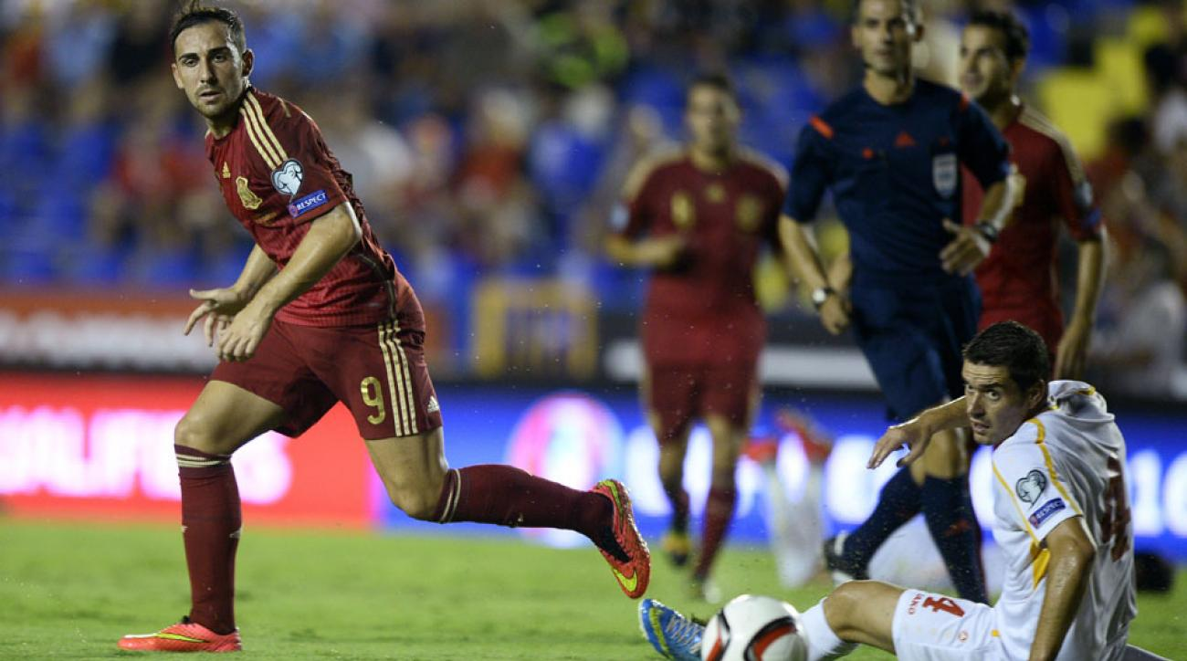Valencia striker Paco Alcaer scored his first goal with the Spanish national team in a 5-1 Euro 2016 qualifier win over Macedonia.