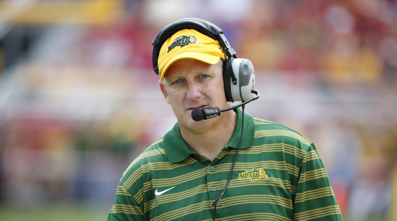 Head coach Chris Klienman of the North Dakota State Bison coaches from the sidelines in the second half of play at Jack Trice Stadium on August 30, 2014 in Ames, Iowa. North Dakota State defeated Iowa State 34-14.