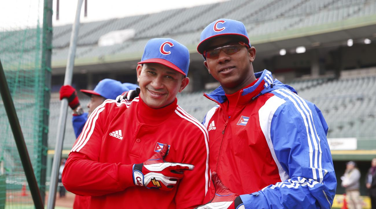 Yasmani Tomas, right, played for Cuba in last year's World Baseball Classic
